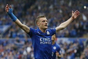 Jamie Vardy celebrates after scoring the third goal for Leicester City.