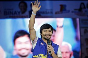 Filipino boxing champion and senate candidate Manny Pacquiao gestures during the last presidential candidates' campaign rally, in Manila, on May 7, 2016.