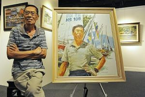 Lee Boon Wang at the gallery last week with his 1989 oil self-portrait as a sailor.
