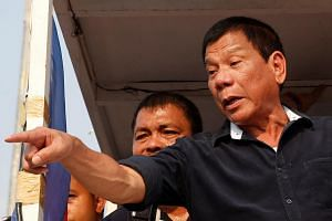 Rodrigo Duterte greeting supporters during election campaigning in Malabon, Metro Manila in the Philippines, on April 27, 2016.