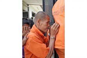 The monk and his female companion allegedly assaulted an Indonesian maid after she refused to marry him.