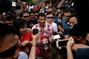 Mr Rodrigo Duterte leaving the voting precinct after casting his vote at Daniel Aguinaldo National High School in Davao City, Mindanao on May 9, 2016.