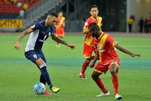 Jermaine Pennant of Tampines Rovers (left) eludes Selangor's Veenod Subramaniam during the 1-0 win in the Asian Football Confederation group-stage game yesterday.