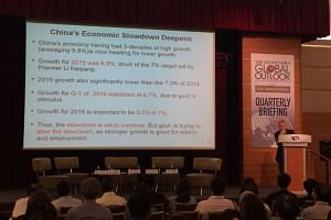 Professor John Wong of the East Asian Institute at the National University of Singapore giving a presentation on China's slowing economy at The Straits Times Global Outlook Forum quarterly briefing on Wednesday (May 11).