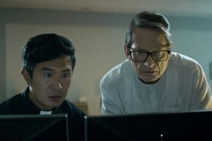 In The Faith Of Anna Waters, Colin Borgonon (right) and Adrian Pang play Catholic priests who see signs of the apocalypse in the data streams of the Internet.