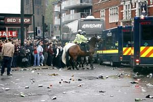 Bottles are thrown at the Manchester United team bus before the match.