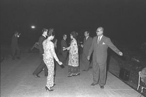 Malaysian Prime Minister Tengku Abdul Rahman (right) and Minister for Finance Dr Goh Keng Swee (second from right) dancing the joget during opening of Rumah Temasek at Kuala Lumpur in November 1963.