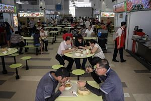 People eat at the hawker centre at Ci Yuan Community Club. The words 'hawker centre' can be found in the Oxford English Dictionary (OED).