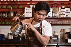 Mr Lucky Salvador, head trainer at Common Man Coffee Roasters, demonstrating how to brew coffee with an Aeropress Coffee Maker.
