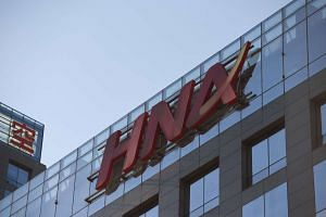 The HNA logo is seen on a building in Beijing on Feb 18, 2016.