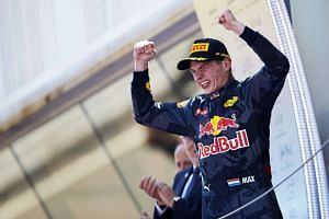 Dutch Formula One driver Max Verstappen of Red Bull Racing celebrates after winning the Spanish Formula One Grand Prix at the Barcelona-Catalunya circuit in Montmelo, Barcelona, Spain, on May 15, 2016.