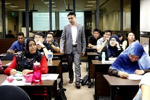 Lecturer Wong Yi conducting a law class at Temasek Polytechnic for part-time students.