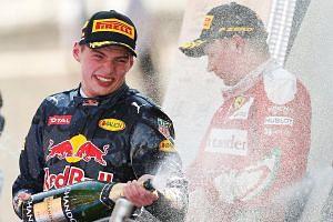 Max Verstappen (left) celebrates with Ferrari F1 driver Kimi Raikkonen after winning Spanish Grand Prix.