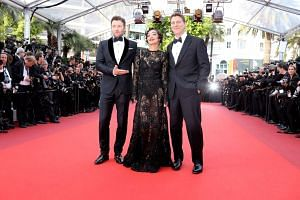 (From left) Australian actor Joel Edgerton, Irish-Ethiopian actress Ruth Negga and US director Jeff Nichols arrive for the screening of the film Loving at the 69th Cannes Film Festival, on May 16, 2016.