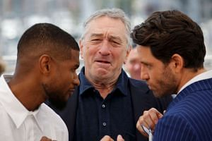 Cast members Robert De Niro (center), Edgar Ramirez (right) and Usher Raymond IV pose during a photocall for the film Hands Of Stone at the 69th Cannes Film Festival in Cannes, France, May 16, 2016.