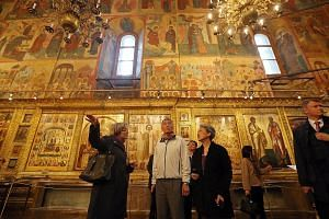 PM Lee and Mrs Lee inside the Dormition Cathedral of the Moscow Kremlin yesterday. At Red Square and the Kremlin, he bumped into Singaporeans on holiday.