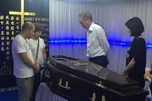 Deputy Prime Minister Teo Chee Hean and Pasir Ris-Punggol GRC MP Sun Xueling at the wake of Mr Lim Hang Chiang, who died on Monday after a lift accident. With them are Mr Lim's older son Eric and daughter Amerly.