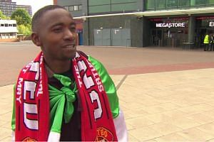 A screenshot of airport worker Moses Kamara from Sierra Leone being interviewed after fans helped him get to see the match.
