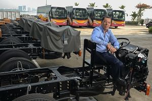 SC Auto chairman Tan Siow Chua at the bus-maker's Senoko Road premises. Aside from servicing the Singapore market, the firm also has a branch in Hong Kong, and will begin construction of a plant in Myanmar this year to boost production.