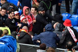 Sevilla and Liverpool supporters fight pior to the Uefa Europa League final.