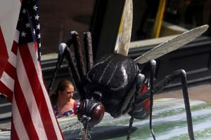 A woman walks past a giant fake mosquito as part of an awareness campaign about the Zika virus in Chicago, United States, on May 16, 2016.