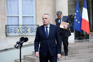 French Foreign minister Jean-Marc Ayrault (foreground) after a crisis meeting of top ministers at the Elysee Presidential palace in Paris on May 19, 2016.