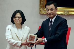 Taiwan's President Tsai Ing-wen (left) receiving an official seal after swearing in at the Presidential Office in Taipei, Taiwan, on May 20, 2016.