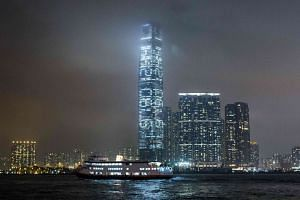"""A light show featuring a countdown of seconds remaining until July 1, 2047, when the """"one country, two systems"""" framework is due to expire, is seen on the facade of the International Commerce Centre."""