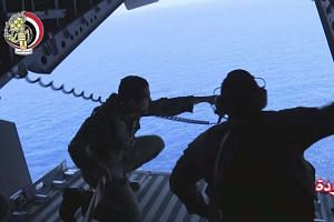 A screengrab from a handout video from the Egyptian Defence Ministry shows Egyptian Navy engaged in search operations for EgyptAir flight MS804 at sea off the Egyptian coast, on May 20, 2016.