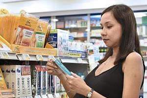 Ms Nicole Conceicao shops for insect repellent.