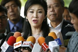 Former Thai Prime Minister Yingluck Shinawatra speaking to the media before her trial in Bangkok on May 18, 2016.