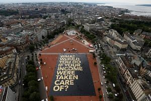 A 8,000 sq m poster on the Plainpalais square in Geneva calling for unconditional basic income.
