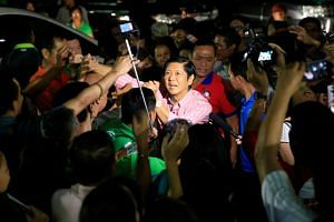 "Philippine vice-presidential candidate senator Ferdinand ""Bongbong"" Marcos Jr., son of late dictator Ferdinand Marcos, is greeted by members of religious group El Shaddai."