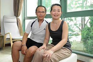 Ms Lim with her husband, Mr Goh. The left half of Ms Lim's body remains weak and she has to use a wheelchair to get around. Her parents-in-law are taking care of her youngest child as she is unable to do so herself. But Ms Lim says being positive goe