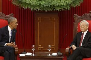 US President Barack Obama (left) and Vietnam's Communist Party General Secretary Nguyen Phu Trong talk in Hanoi, Vietnam, on May 23.