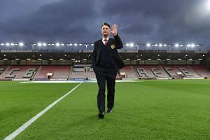 Louis van Gaal waves before a match against Bournemouth in December, 2015.
