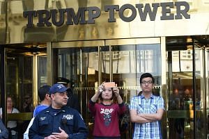 Tourists make their way through Trump Tower on 5th Avenue in New York on May 23.