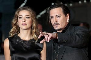 Johnny Depp and Amber Heard arriving for the premiere of the film Black Mass in London on Oct 11, 2015.