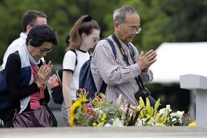 People offer prayers at Hiroshima Peace Memorial Park ahead of US President Barack Obama's visit to the city.
