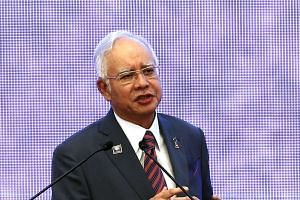 Malaysia's Prime Minister Najib Razak speaks at the 48th Association of Southeast Asian Nations (ASEAN) foreign ministers meeting in Kuala Lumpur, on Aug 4, 2015.