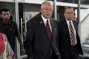 Malaysia's Prime Minister Najib Razak (left) leaves his office at the parliament in Kuala Lumpur on May 25, 2016.