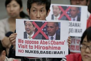 People protesting the visit to Hiroshima by Japanese PM Shinzo Abe and US President Barack Obama at the Hiroshima Peace Memorial Park on May 26.