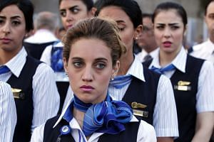 EgyptAir flight crew attend a candlelight vigil for the victims of EgyptAir flight MS804 in Cairo on May 26, 2016.