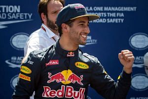 Ricciardo celebrates after qualifying for pole in Monaco on May 28, 2016.