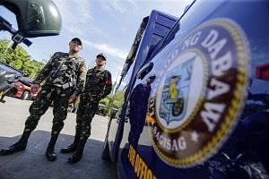 Police officers stand guard in Davao City, southern Philippines, on May 16, 2016.