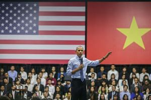 Mr Obama addressing Vietnamese youth, members of the Young South-east Asian Leaders Initiative programme, at the GEM Centre in Ho Chi Minh City, Vietnam, on Wednesday. This is Mr Obama's first visit to Vietnam. He is the third US President to visit the So