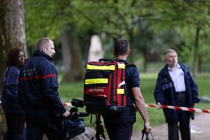 Firefigthers walk at the entrance of Parc Monceau on May 28, 2016 in Paris.
