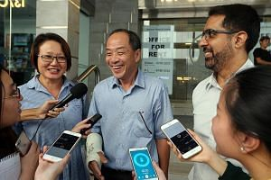 (Right) Mr Low speaking to the media after the CEC election yesterday, alongside Ms Lim and Mr Singh. Mr Low had his arm in a plaster cast after fracturing it in a fall one to two weeks ago. He laughed off a question about whether there was a growing