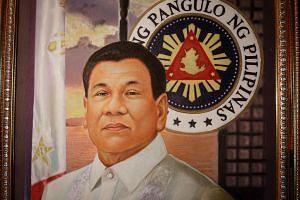 A close-up view of Filipino artist Freddie Luna Cruz' painting of President-elect Rodrigo Duterte in his shop at a mall in Manila.