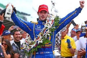 Alexander Rossi celebrates after winning the 100th running of the Indianapolis 500.